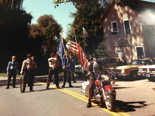 Community Day Parade 1976. On Motorcycle – Ofc. Skip Daly, Color Guard from left to right – Ofc. Victor DeCapua, Ofc. Steve Freddo, Ofc. Brian Smith, Ofc. Edward McCann