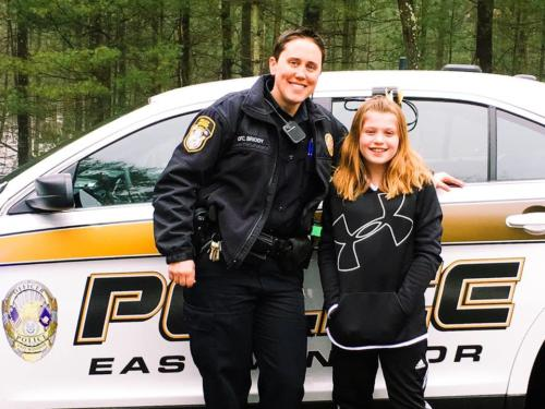 Ofc. Tamrah Briody take a student to school '17