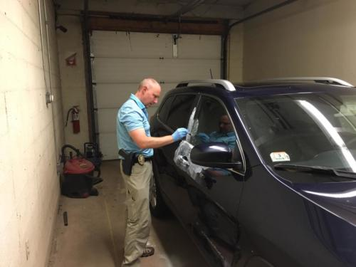Det. Scott Roberts dusting for fingerprints
