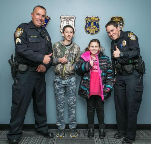 Sgt. Jeff Chant (left) and Ofc. Tamrah Briody Shop With A Cop '16